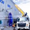 Xe cẩu hỗ trợ lắp đặt thiết bị công trình xây dựng